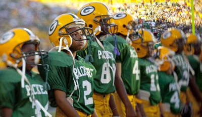 The pop warner Packers before a preseason NFL football game Saturday, Aug. 14, 2010, in Green Bay, Wis. (AP Photo/Mike Roemer)