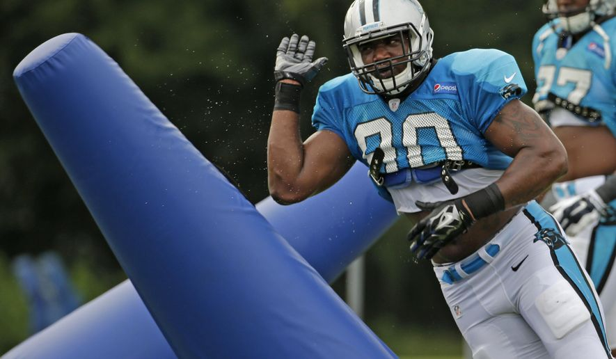 Carolina Panthers' Frank Alexander (90) runs a drill during the NFL football team's training camp in Spartanburg, S.C., Wednesday, Aug. 5, 2015. (AP Photo/Chuck Burton)