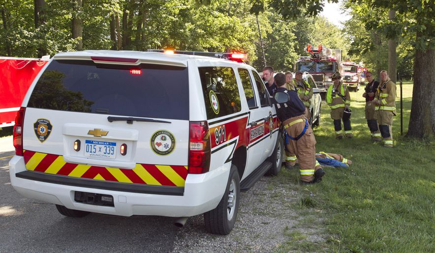Emergency workers respond to a chemical accident at the Grand Rapids Lake Michigan Water Filtration Plant in Grand Haven Township, Mich., Wednesday, Aug. 5, 2015. Authorities say there are no injuries after an accident involving chemicals at a water filtration plant in western Michigan. (Cory Morse/The Grand Rapids Press via AP) ALL LOCAL TELEVISION OUT; LOCAL TELEVISION INTERNET OUT; MANDATORY CREDIT