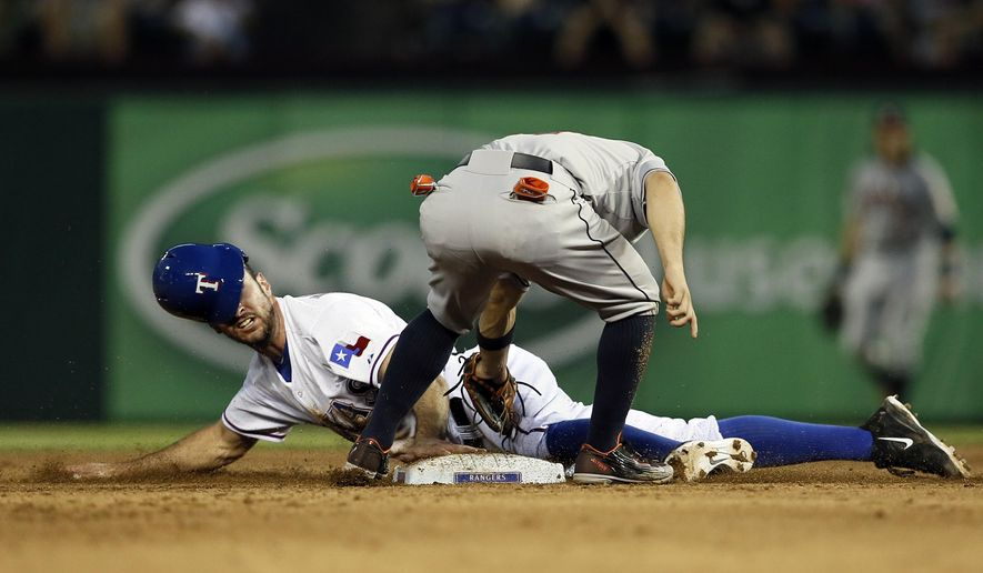 Texas Rangers' Adam Rosales steals second under the attempted tag of Houston Astros' Jose Altuve in the fourth inning of a baseball game, Wednesday Aug. 5, 2015, in Arlington, Texas. (AP Photo/Tony Gutierrez)