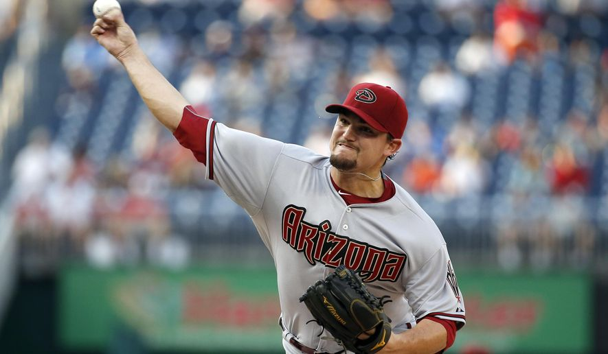 Arizona Diamondbacks starting pitcher Zack Godley throws during the first inning of a baseball game against the Washington Nationals at Nationals Park, Monday, Aug. 3, 2015, in Washington. (AP Photo/Alex Brandon)