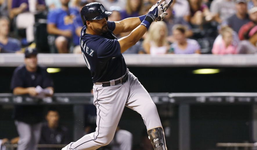Seattle Mariners pinch-hitter Franklin Gutierrez watches his two-run single off Colorado Rockies relief pitcher Christian Friedrich during the sixth inning of a baseball game Tuesday, Aug. 4, 2015, in Denver. (AP Photo/David Zalubowski)