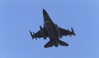 In this Wednesday, July 29, 2015, file photo, a missile-loaded Turkish Air Force warplane rises in the sky after taking off from Incirlik Air Base, in Adana, southern Turkey. (AP Photo/Emrah Gurel, file)