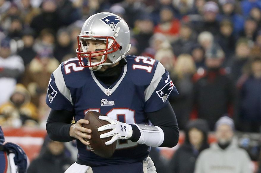 FILE - In this Jan. 10, 2015, file photo, New England Patriots quarterback Tom Brady (12) rolls out to pass against the Baltimore Ravens in the first half of an NFL divisional playoff football game in Foxborough, Mass. The Baltimore Ravens deny they tipped off the Indianapolis Colts about underinflated footballs before the AFC championship game. Court papers released Tuesday in New England quarterback Tom Brady's lawsuit against the NFL over his four-game suspension show that the Ravens contacted the Colts about deflated footballs used in Baltimore's playoff loss to the Patriots the previous week. But the Ravens said Wednesday, Aug. 5, 2015, that was not true. (AP Photo/Elise Amendola)