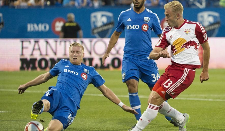 Montreal Impact's Calum Mallace, left, and Victor Cabrera, center, challenge New York Red Bulls' Mike Grella during the first half of an MLS soccer game Wednesday, Aug. 5, 2015, in Montreal. (Graham Hughes/The Canadian Press via AP)