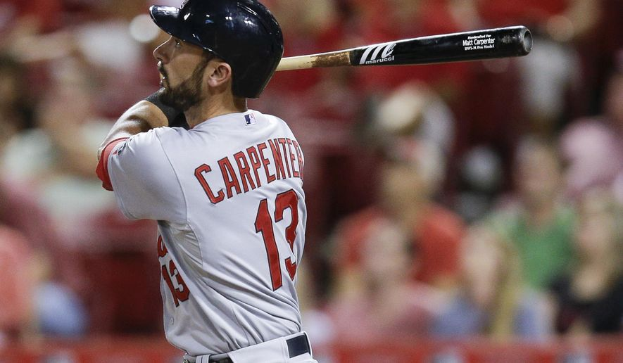 St. Louis Cardinals' Matt Carpenter watches his solo home run off Cincinnati Reds relief pitcher J.J. Hoover during the eighth inning of a baseball game, Wednesday, Aug. 5, 2015, in Cincinnati. (AP Photo/John Minchillo)