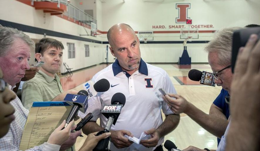 Illinois women's basketball coach Matt Bollant talks with reporters at the Ubben Basketball Practice Complex in Champaign, Ill., Wednesday, Aug. 5, 2015.  Seven former players sued the university, coach Matt Bollant, athletic director Mike Thomas and others on July 1, alleging Bollant and some other coaches used race to divide the team and drive players out. The players are seeking at least $10 million in damages. (Rick Danzl/The News-Gazette via AP)  MANDATORY CREDIT (REV-SHARE)