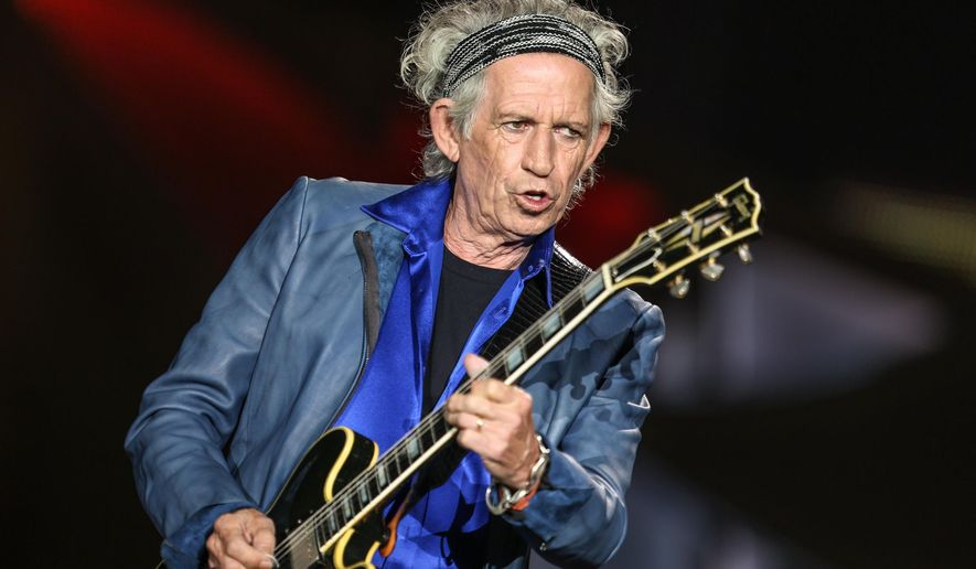 "FILE - In this May 24, 2015 file photo, Keith Richards performs at The Rolling Stones Zip Code Tour opening night in San Diego, Calif. Netflix will premiere an original documentary on Keith Richards. ""Keith Richards - Under the Influence"" will be available Sept. 18, the streaming service announced Tuesday, July 28. (Photo by Rich Fury/Invision/AP, File)"