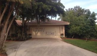 "Vandals spray-painted the words ""lion killer"" on the garage door of the $1.1 million Florida vacation home owned by Walter Palmer, the Minnesota dentist who sparked an international uproar by killing Cecil the lion last month in Zimbabwe. (ABC Action News)"