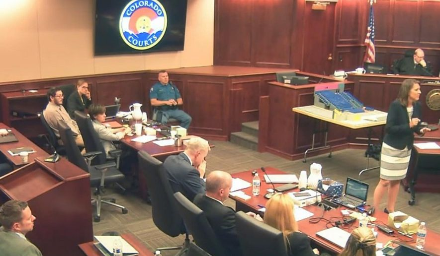 In this image taken from video, defense attorney Tamara Brady, right, gestures during closing arguments in the sentencing phase of the James Holmes trial, in Centennial, Colo., Thursday, Aug. 6, 2015. Holmes sits second from left in a light shirt. (Colorado Judicial Department via AP, Pool)