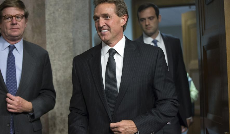 In this July 23, 2015, photo, Sen. Jeff Flake, R-Ariz., arrives before Secretary of State John Kerry, Secretary of Energy Ernest Moniz, and Secretary of Treasury Jack Lew, arrive to testify at a Senate Foreign Relations Committee hearing on Capitol Hill, in Washington. Flake has purposely spent time on deserted islands, so being the sole Senate Republican weighing whether to back President Barack Obama on the international nuclear deal with Iran is hardly a new experience.  (AP Photo/Andrew Harnik)