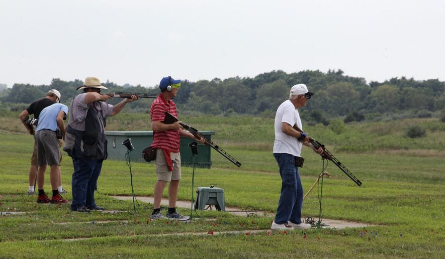 In this Wednesday, Aug. 5, 2015 photo, a squad of shooters participate in opening day competition at the Grand American World Trapshooting Tournament at the World Shooting and Recreation Complex in Sparta, Ill. The state of Illinois plans at the end of this month to close a money-losing shooting complex that regularly draws thousands each summer for the national competition. The Illinois Department of Natural Resources says it costs $3 million each year to operate the site, which brings in $1.1 million in annual revenue. (Les Winkeler/The Southern via AP)  MANDATORY CREDIT
