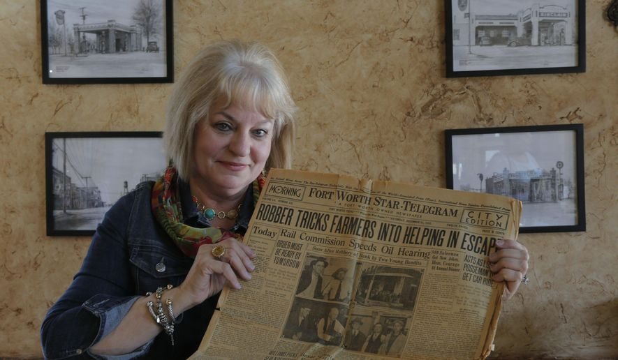 ADVANCE FOR USE SUNDAY, AUG. 9 - In this photo taken July 27, 2015,  Debi Meek talks as she holds a newspaper a customer found on eBay with a story about by two Dallas crooks who were known associates of Bonnie and Clyde that robbed the bank where her Grapevine, Texas, business is now located. Although Bonnie Parker and Clyde Barrow were not involved in the robbery, Grapevine history aficionados have long had an interest in the couple because of their connection to the city, said Grapevine Mayor William D. Tate. (Rodger Mallison/Star-Telegram via AP)  MAGS OUT; (FORT WORTH WEEKLY, 360 WEST); INTERNET OUT; MANDATORY CREDIT