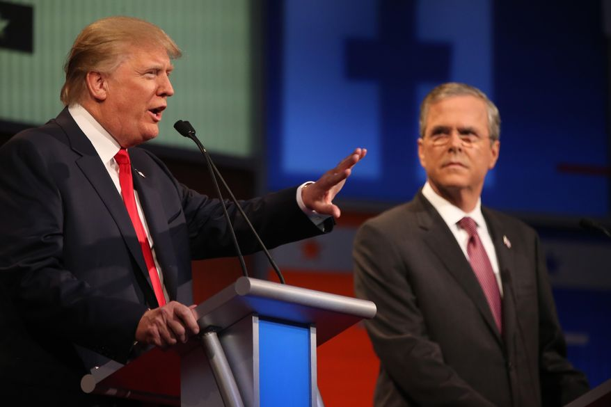 Republican presidential candidate Donald Trump, left, speaks as Jeb Bush listens during the first Republican presidential debate at the Quicken Loans Arena Thursday, Aug. 6, 2015, in Cleveland. (AP Photo/Andrew Harnik) ** FILE **