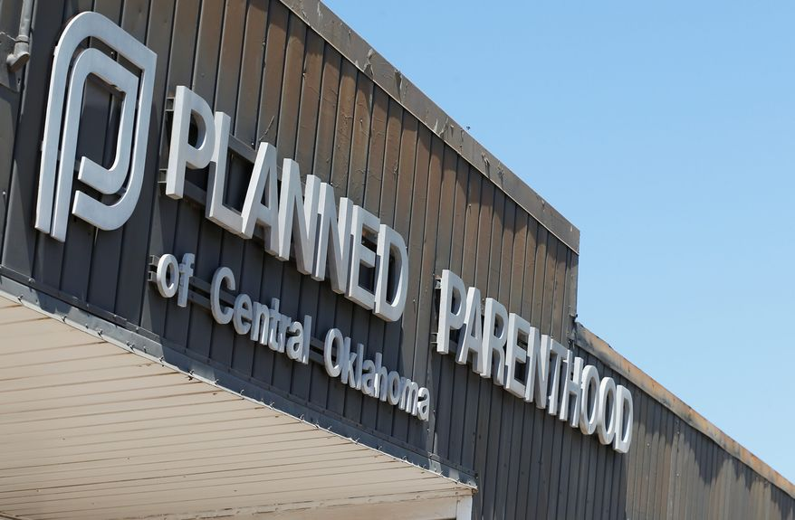 A sign at a Planned Parenthood Clinic is pictured in Oklahoma City, Friday, July 24, 2015. (AP Photo/Sue Ogrocki/File)