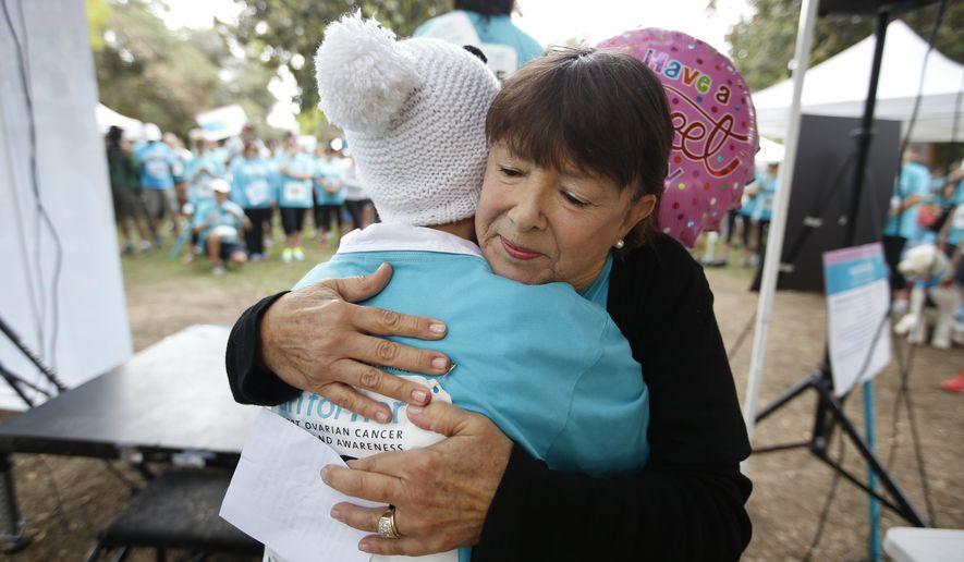 Participants prepare for the Cedars-Sinai Inaugural Run for Her Bay Area 5K run and Friendship Walk in Los Gatos, Calif., on Saturday, Sept. 20, 2014. (Tony Avelar/AP Images for Cedars-Sinai)