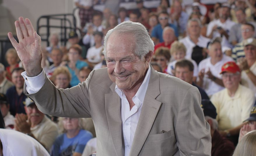Evangelist Pat Robertson acknowledges the crowd before Republican presidential candidate Mitt Romney campaigns at the Military Aviation Museum in Virginia Beach, Va., Saturday, Sept. 8, 2012. (AP Photo/Charles Dharapak)