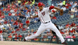 Washington Nationals starting pitcher Joe Ross throws to an Arizona Diamondbacks batter during a baseball game in Washington on Thursday, Aug. 6, 2015. The Nationals won 8-3. (AP Photo/Jacquelyn Martin)