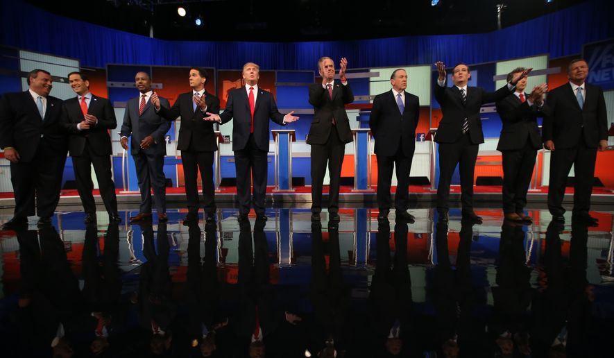 Republican presidential candidates from left, Chris Christie, Marco Rubio, Ben Carson, Scott Walker, Donald Trump, Jeb Bush, Mike Huckabee, Ted Cruz, Rand Paul, and John Kasich take the stage for the first Republican presidential debate at the Quicken Loans Arena Thursday, Aug. 6, 2015, in Cleveland. (Associated Press)