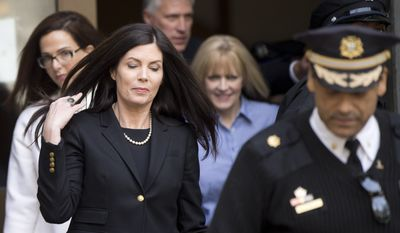 Pennsylvania Attorney General Kathleen Kane walks to her vehicle, Wednesday, March 11, 2015, from the State Supreme Court room at City Hall in Philadelphia. The court heard arguments on the legality of a special prosecutor who led a grand jury investigation. The grand jury has recommended charges against her.  (AP Photo/Matt Rourke)