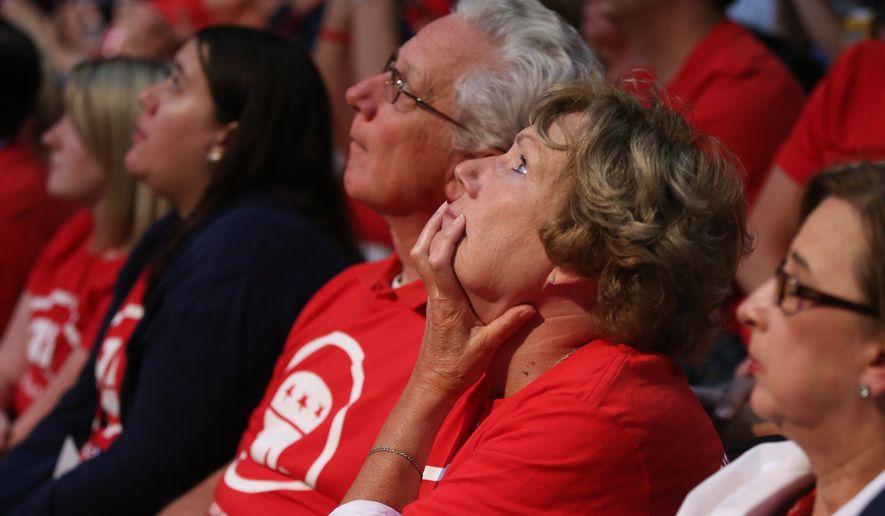 Onlookers watch debate in Cleveland arena.