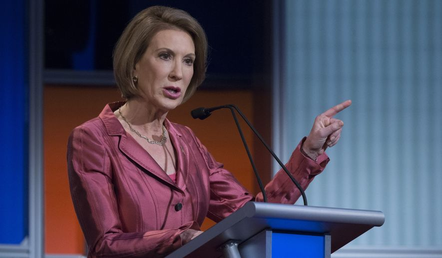 Republican presidential candidate Carly Fiorina participates a pre-debate forum at the Quicken Loans Arena, Thursday, Aug. 6, 2015, in Cleveland. Seven of the candidates have not qualified for the primetime debate. (AP Photo/John Minchillo) ** FILE **