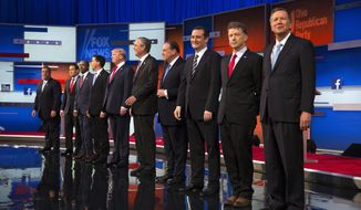Republican presidential candidates from left, Chris Christie, Marco Rubio, Ben Carson, Scott Walker, Donald Trump, Jeb Bush, Mike Huckabee, Ted Cruz, Rand Paul, and John Kasich take the stage for the first Republican presidential debate at the Quicken Loans Arena Thursday, Aug. 6, 2015, in Cleveland. (AP Photo/John Minchillo) ** FILE **