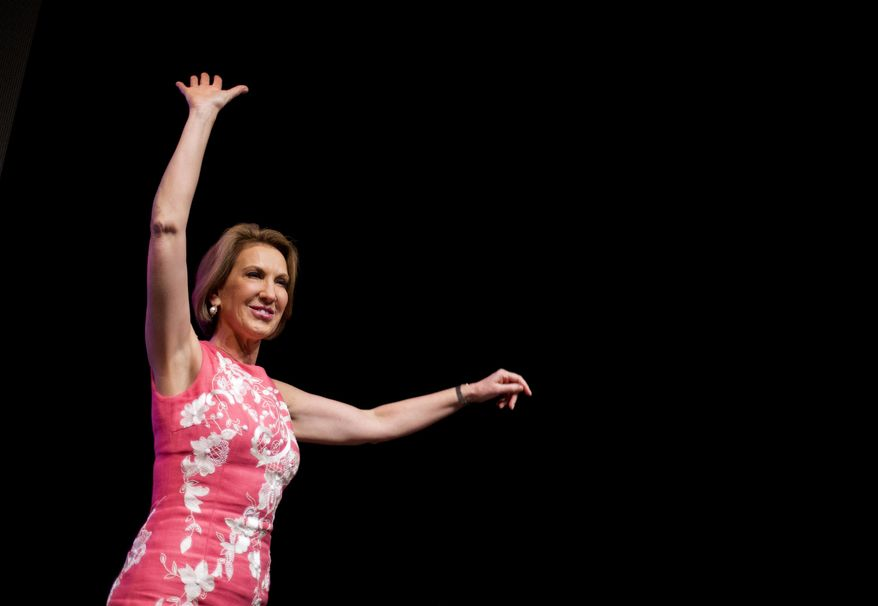 Republican presidential candidate Carly Fiorina waves to the crowd after speaking at the RedState Gathering, Friday, Aug. 7, 2015, in Atlanta. (AP Photo/David Goldman)