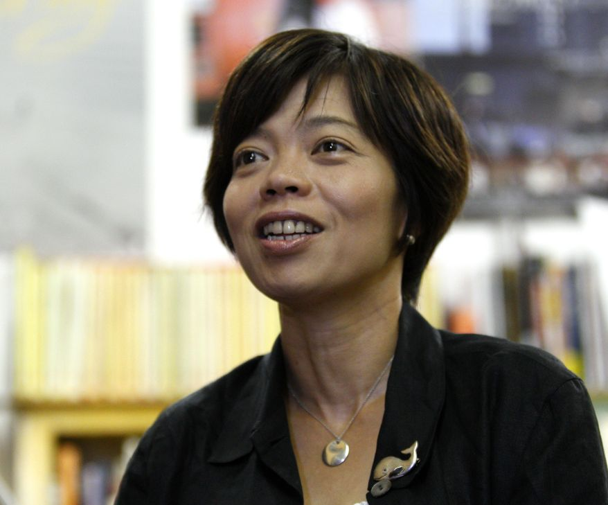 """Director Keiko Yagi speaks during an interview in Tokyo, Friday, Aug. 7, 2015. Her new documentary, """"Behind the Cove,"""" is being billed as Japan's big rebuttal to the Oscar-winning """"The Cove,"""" which depicted the dolphin slaughter in the tiny town of Taiji that horrified the world. (AP Photo/Ken Aragaki)"""