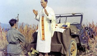 Father Emil Joseph Kapaun, serving on the battlefields of the Korean War. Image in the public domain.