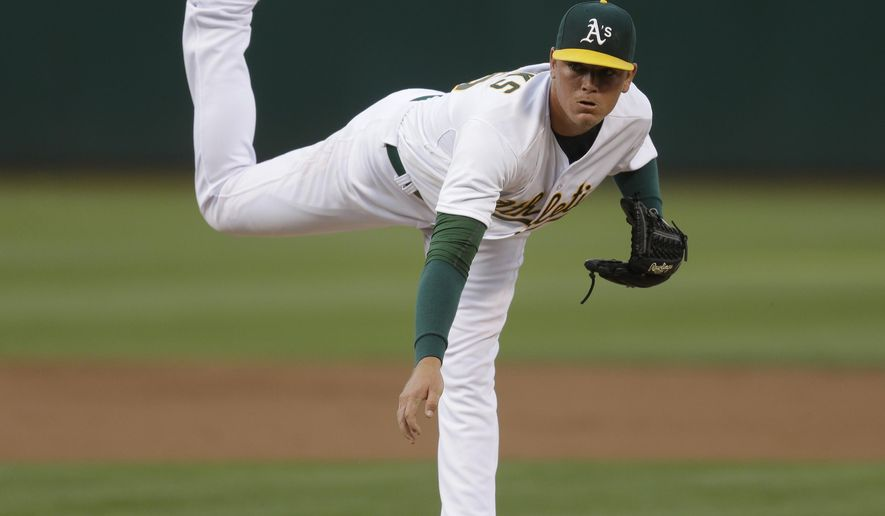 Oakland Athletics pitcher Aaron Brooks works against the Houston Astros in the first inning of a baseball game Thursday, Aug. 6, 2015, in Oakland, Calif. (AP Photo/Ben Margot)