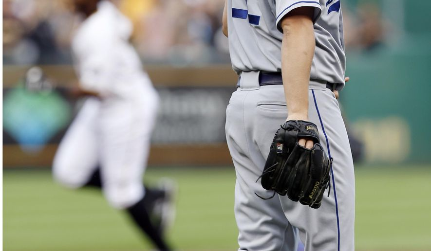 Los Angeles Dodgers starting pitcher Clayton Kershaw, right, looks toward left field as Pittsburgh Pirates' Gregory Polanco rounds the bases after hitting a solo home run in the first inning of a baseball game, Friday, Aug. 7, 2015, in Pittsburgh. (AP Photo/Keith Srakocic)