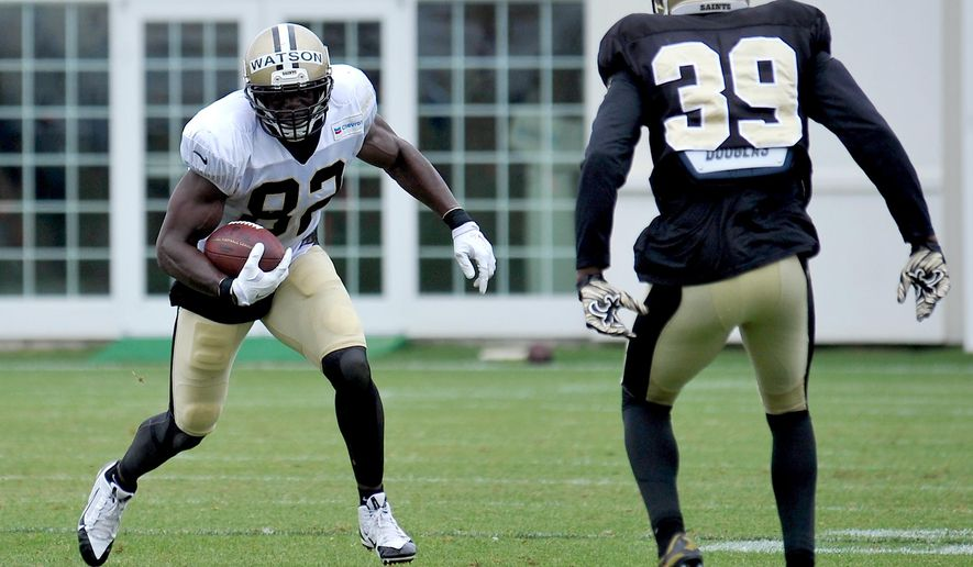 New Orleans Saints tight end Benjamin Watson (82) runs the ball in a scrimmage game during the team's NFL football training camp in White Sulphur Springs, W. Va., Friday, Aug. 7, 2015. (AP Photo/Chris Tilley)