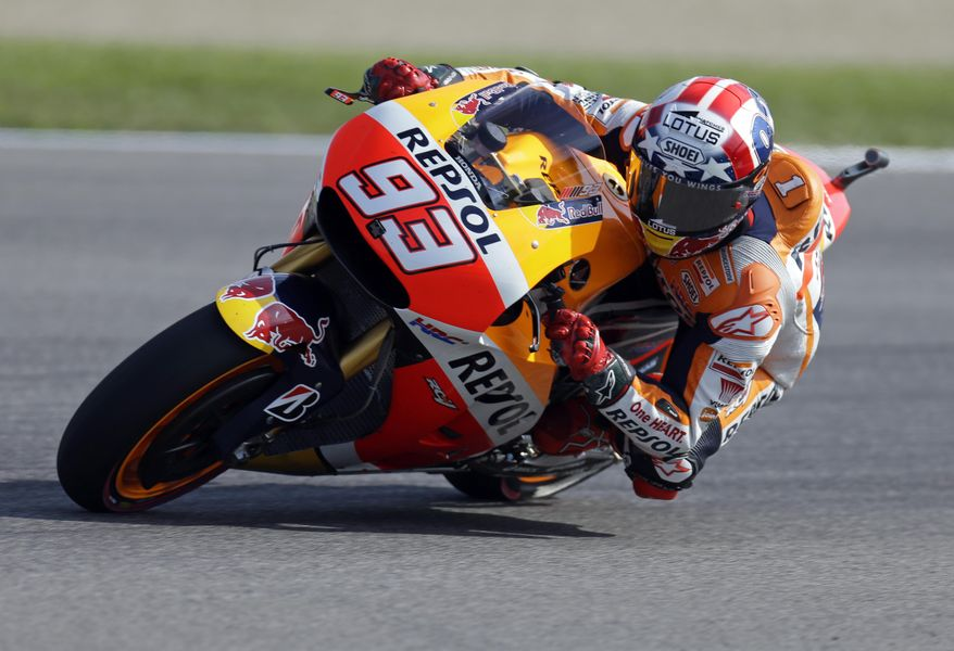 Marc Marquez, of Spain, rides through a turn during the third practice for the Indianapolis Grand Prix motorcycle race at Indianapolis Motor Speedway in Indianapolis, Saturday, Aug. 8, 2015. (AP Photo/Michael Conroy)