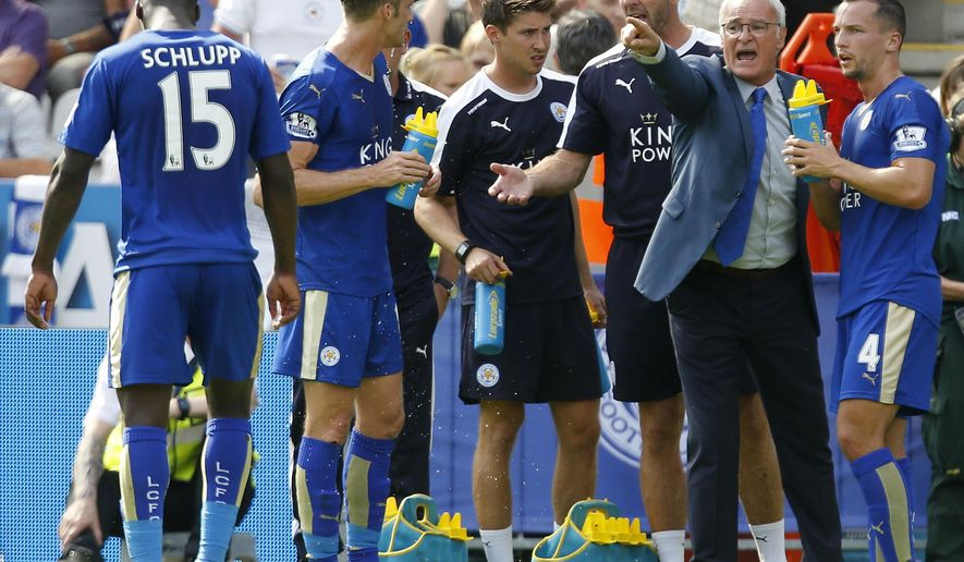 Leicester City's manager Claudio Ranieri, second right, gives instructions to Danny Drinkwater during the English Premier League soccer match  against Sunderland at the King Power Stadium, Leicester, England  Saturday Aug. 8, 2015.  (Paul Harding/PA  via AP)  UNITED KINGDOM OUT