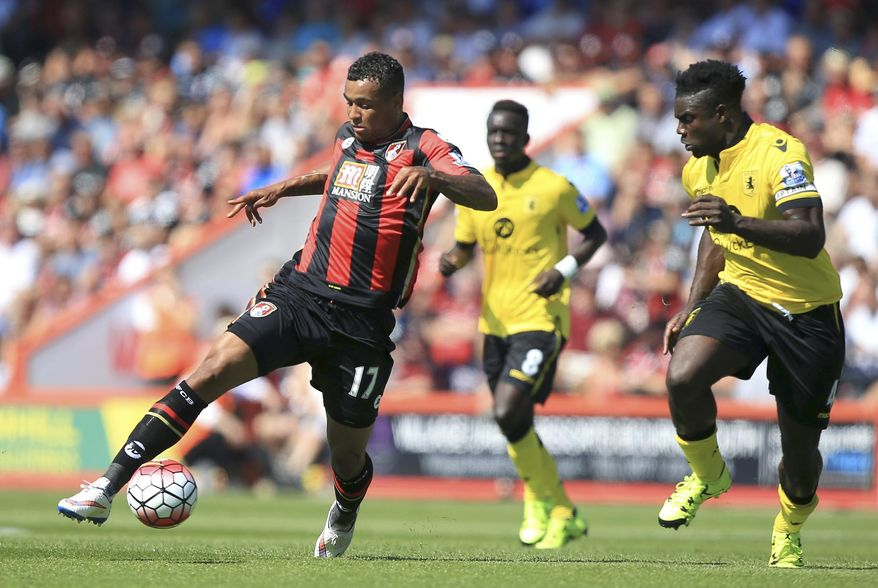 Bournemouth's Joshua King, left, and Aston Villa's Micah Richards, in action during their English Premier League match at the Vitality Stadium, Bournemouth, England  Saturday Aug. 8, 2015. (John Walton/PA via AP)  UNITED KINGDOM OUT
