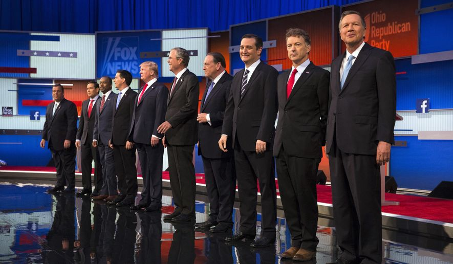 Republican presidential candidates from left, Chris Christie, Marco Rubio, Ben Carson, Scott Walker, Donald Trump, Jeb Bush, Mike Huckabee, Ted Cruz, Rand Paul, and John Kasich take the stage for the first Republican presidential debate at the Quicken Loans Arena Thursday, Aug. 6, 2015, in Cleveland. (AP Photo/John Minchillo)