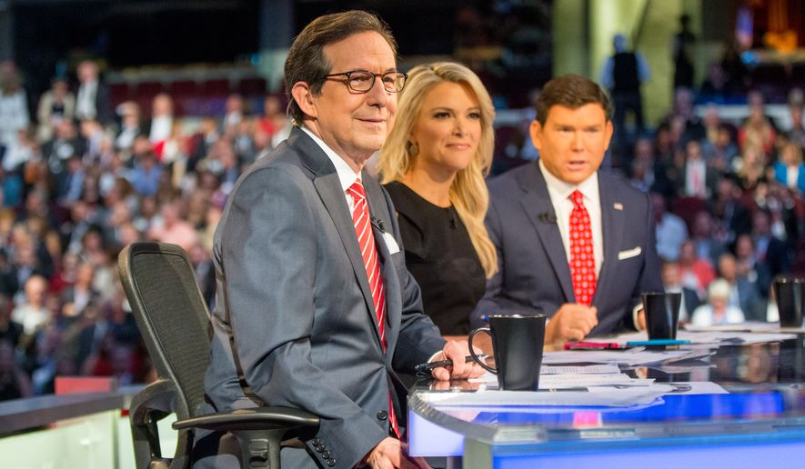 Fox News moderators (from left) Chris Wallace, Megyn Kelly and Bret Baier speak to the camera before Republican presidential candidates New Jersey Gov. Chris Christie, Sen. Marco Rubio, R-Fla., Ben Carson, Wisconsin Gov. Scott Walker, Donald Trump, former Florida Gov. Jeb Bush, former Arkansas Gov. Mike Huckabee, Sen. Ted Cruz, R-Texas, Sen. Rand Paul, R-Ky., and Ohio Gov. John Kasich take the stage for the first Republican presidential debate at the Quicken Loans Arena in Cleveland on Aug. 6, 2015. (Associated Press) **FILE**