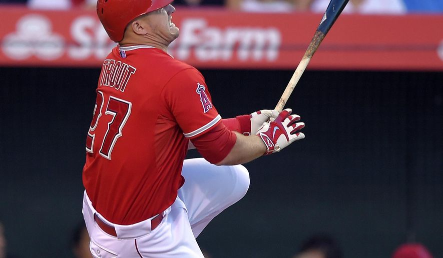 Los Angeles Angels' Mike Trout goes down after fouling a ball off his foot during the fourth inning of a baseball game against the Baltimore Orioles, Saturday, Aug. 8, 2015, in Anaheim, Calif. (AP Photo/Mark J. Terrill)
