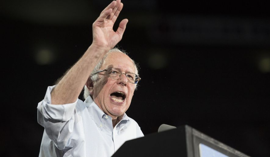 Democratic presidential candidate Sen. Bernie Sanders, I-Vt., speaks at a rally, Sunday, Aug. 9, 2015, at the Moda Center in Portland, Ore. (AP Photo/Troy Wayrynen)