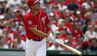 Washington Nationals' Ryan Zimmerman (11), watches his second solo home run during the third inning of a baseball game against the Colorado Rockies at Nationals Park, Sunday, Aug. 9, 2015, in Washington. (AP Photo/Alex Brandon) **FILE**