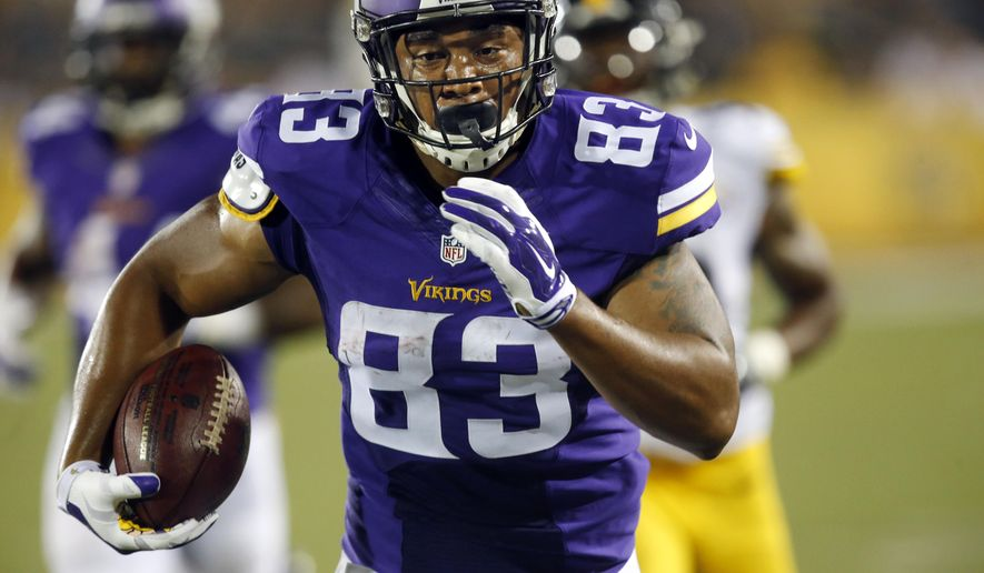 Minnesota Vikings tight end MyCole Pruitt heads to the end zone for a touchdown after taking a pass from quarterback quarterback Mike Kafka during the first half of an NFL preseason football game against the Pittsburgh Steelers in Canton, Ohio,  Sunday, Aug. 9, 2015. (AP Photo/Tom E. Puskar)