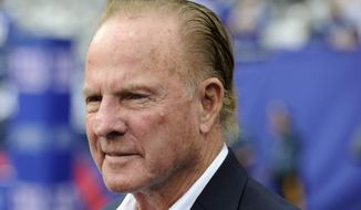 Former New York Giants player Frank Gifford looks on before an NFL football game between the New York Giants and the Denver Broncos in East Rutherford, N.J., in this Sept. 15, 2013, file photo. Gifford's family on Sunday, Aug. 9, 2015, said Gifford died suddenly at age 84. (AP Photo/Bill Kostroun, File)