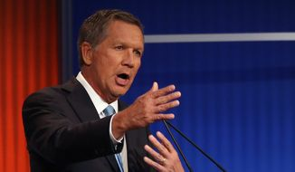 Ohio Gov. John Kasich received enthusiastic applause at the Republican presidential debate Thursday when he said he would prefer traditional marriage but added that love and compassion compel an open attitude. (Associated Press)