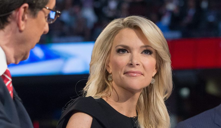 Donald Trump implied that Fox News' Megyn Kelly possibly asked him tough questions at Thursday evening's GOP primary debate due to her menstrual cycle. Mr. Trump doubled down by citing his record on hiring and promoting women at his companies. (Associated Press) **FILE**