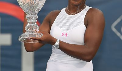 Sloane Stephens poses with the trophy after she defeated Anastasia Pavlyuchenkova 6-1, 6-2, in the women's singles final at the Citi Open on Sunday. Stephens was competing in her first career WTA final. (Associated Press)