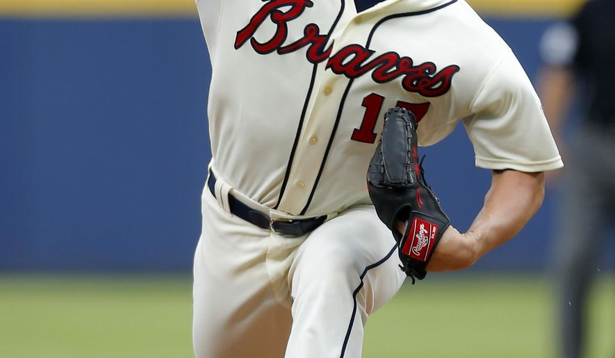 Atlanta Braves starting pitcher Shelby Miller (17) delivers in the first inning of a baseball game against the Miami Marlins, Sunday, Aug. 9, 2015, in Atlanta. (AP Photo/Todd Kirkland)