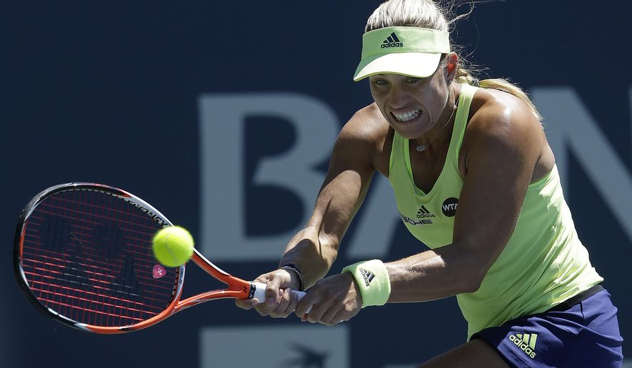 Angelique Kerber, from Germany, returns the ball to Karolina Pliskova, from Czech Republic, during the championship match in the Bank of the West Classic tennis tournament in Stanford, Calif., Sunday, Aug. 9, 2015. (AP Photo/Jeff Chiu)