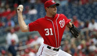 Washington Nationals starting pitcher Max Scherzer (31) throws during the third inning of a baseball game against the Colorado Rockies at Nationals Park, Sunday, Aug. 9, 2015, in Washington. (AP Photo/Alex Brandon)