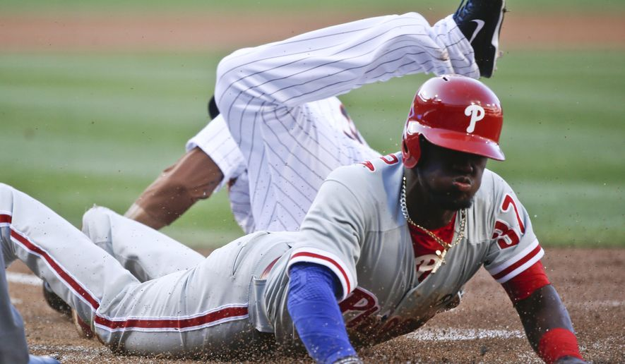 Philadelphia Phillies' Odubel Herrera scores from third on a wild pitch during the first inning of a baseball game against the San Diego Padres on Saturday, Aug. 8, 2015, in San Diego. (AP Photo/Lenny Ignelzi)